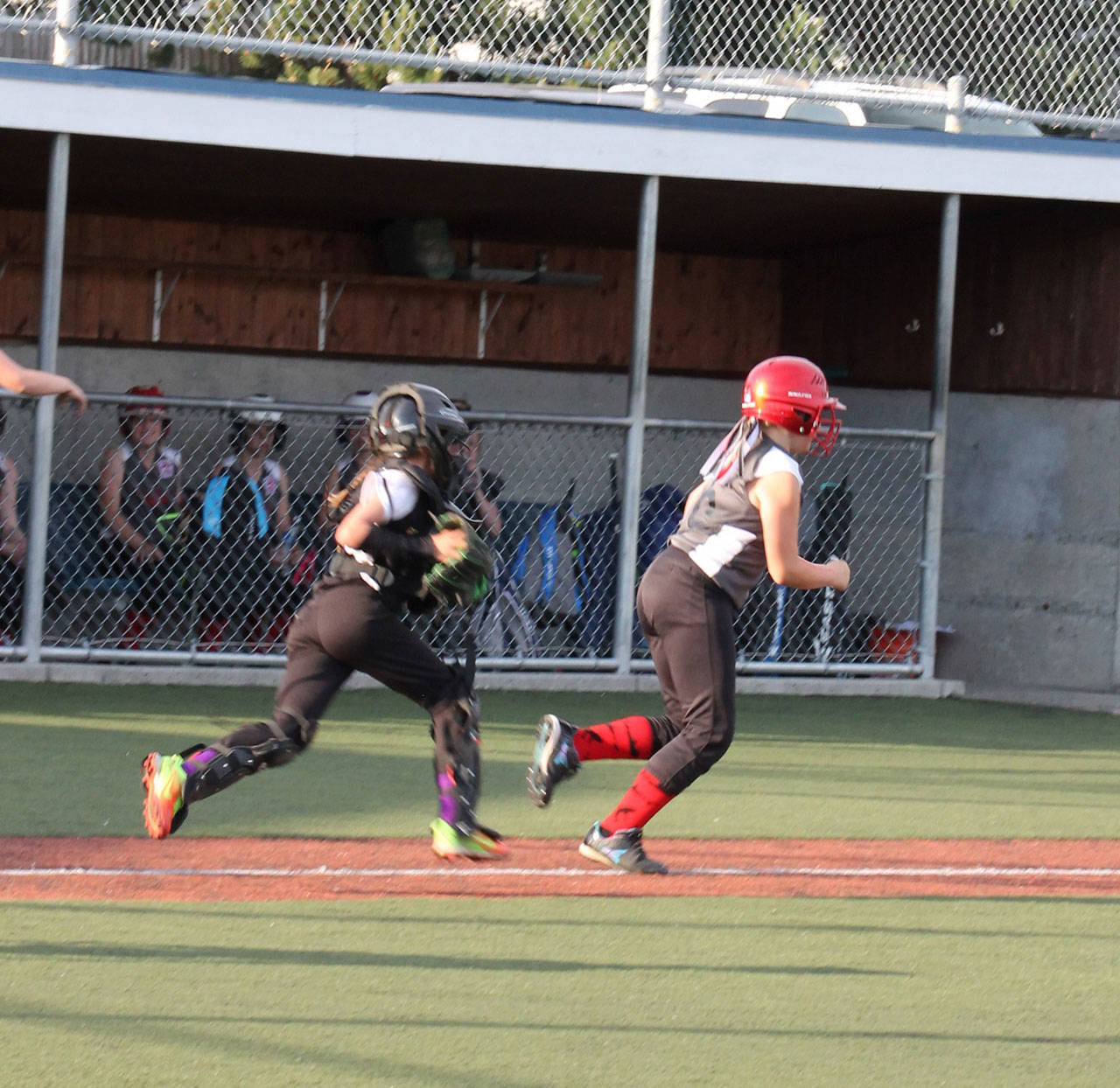 North Whidbey's Lilly Norman (catcher) and Central Whidbey's Mimi Forde.(Submitted photo)