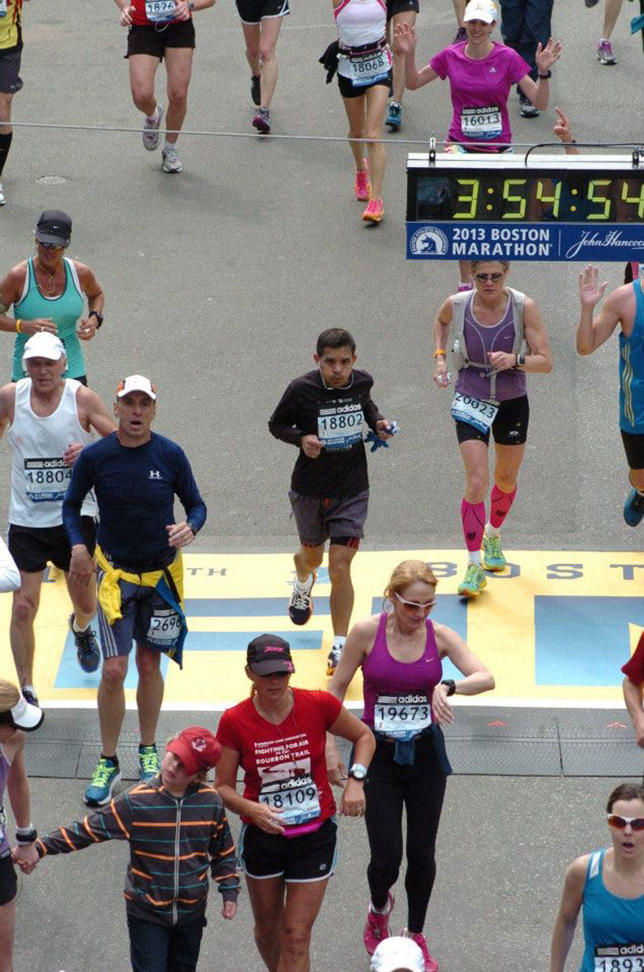 Mendoza (18802) crosses the finish line of the Boston Marathon. (Submitted photo)