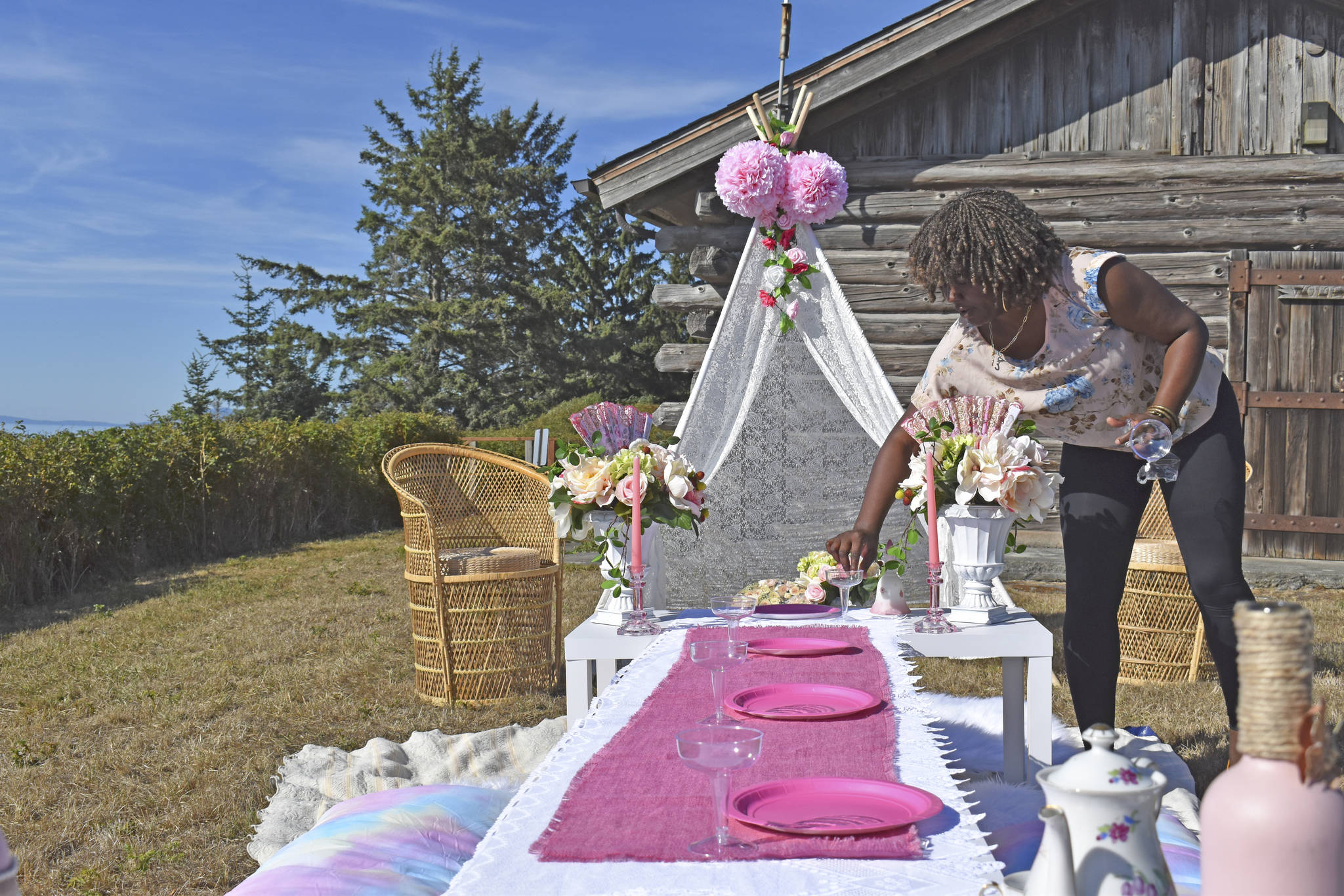 Photo by Emily Gilbert/Whidbey News-Times Cadesha Pacquette sets up a pop-up picnic spread similar to one she created for a young girl's birthday party. Pacquette said her new venture has been popular with military families celebrating a spouse's return from deployment, anniversaries or just to have fun outdoors.